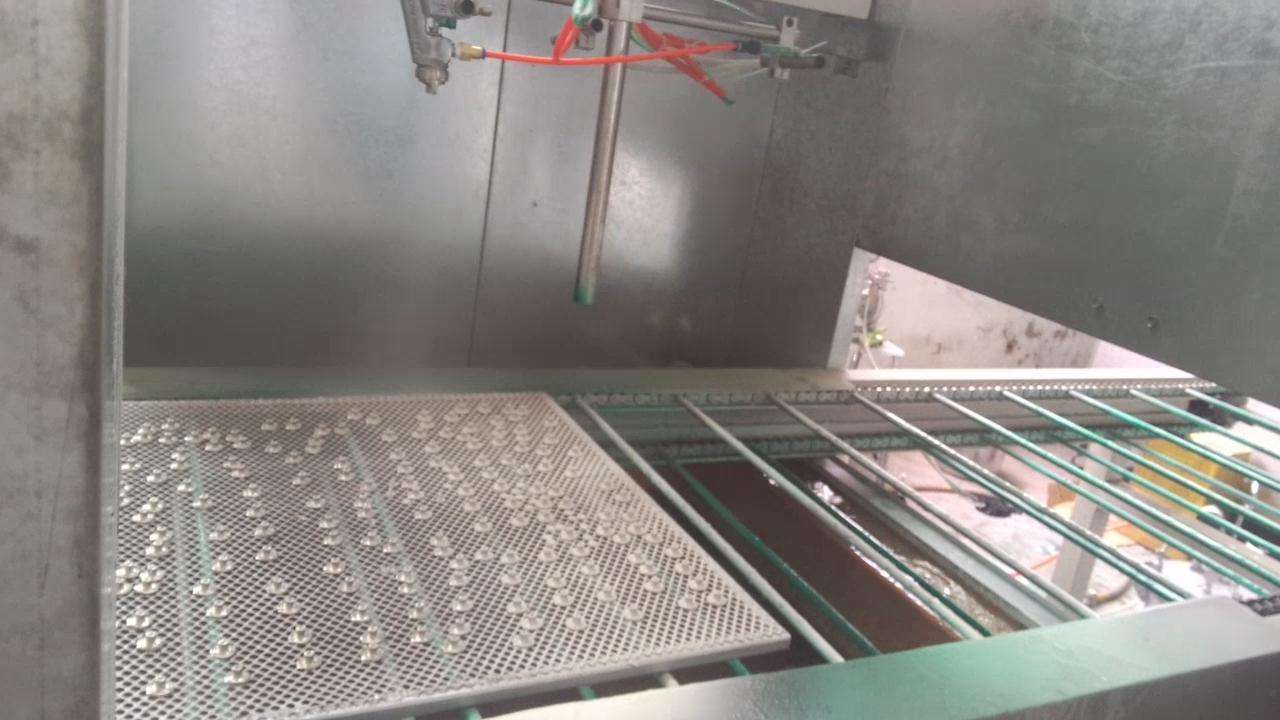 Uniaxial machine sprayed metal buttons Product Case